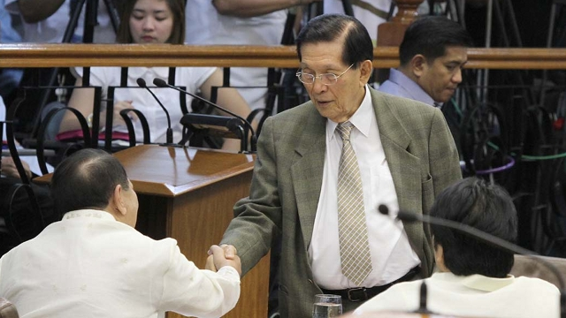 'HOPE YOU'RE RIGHT.' Senate President Juan Ponce Enrile shakes hands with Sen Edgardo Angara who voted for the RH bill. In his speech, Enrile told RH proponents he hopes they will be proven right. Photo by Senate PRIB