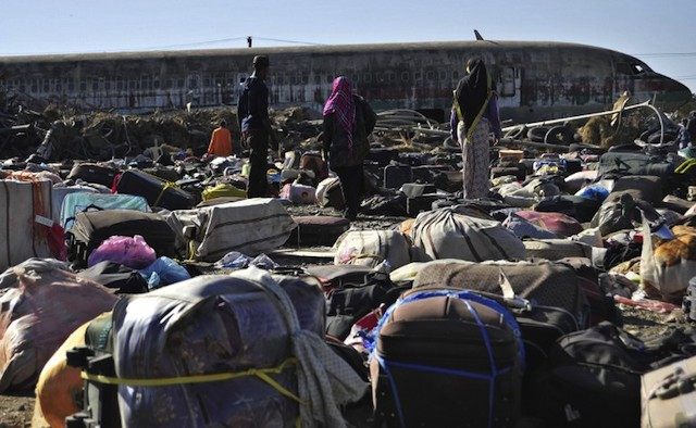 BACK HOME. Ethiopian immigrants returning from Saudi Arabia searching for their luggages among unclaimed bags at Addis Ababa's Bole International Airport, December 10, 2013. AFP/Jenny Vaughan