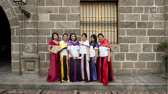 Ladies in 'Maria Clara' costumes in Intramuros (the attire is named after a female character in Jose Rizal's 'Noli Me Tangere')