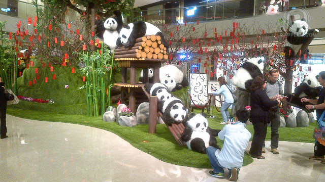 Panda display in ifc Mall, Central, Hong Kong Island. Take note of 'lai see' packets hanging from the tree.