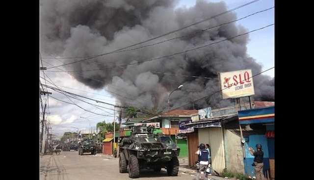 ESCALATING: Nur Misuari's followers burn more houses in Sta Catalina, Zamboanga City. Photo by Richard Falcatan