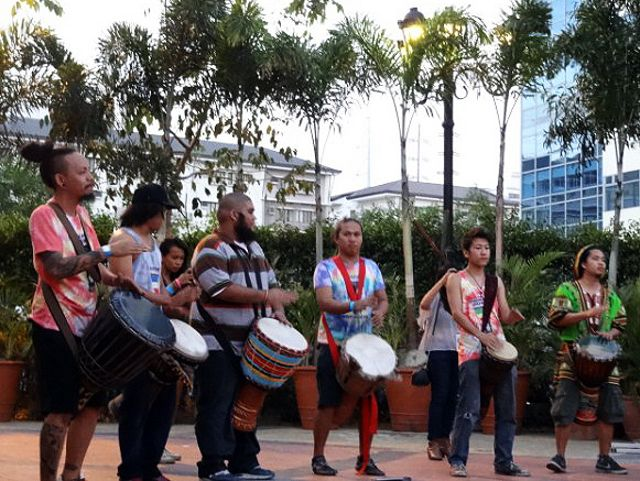 Djembe drummers play in a drum circle for the sunset spin jammers