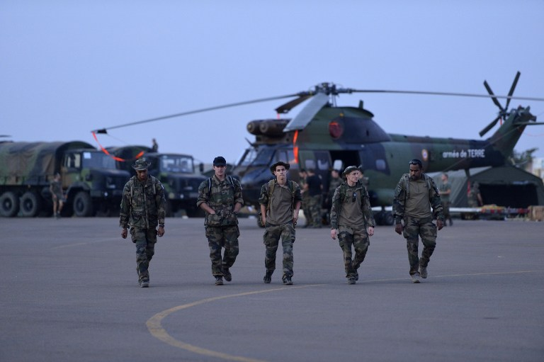 IN MALI. French soldiers from the 5th RHC (Combat Helicopter Regiment) walk on the flight path on January 20, 2013 at the 101st airbase near Bamako. AFP PHOTO / ERIC FEFERBERG