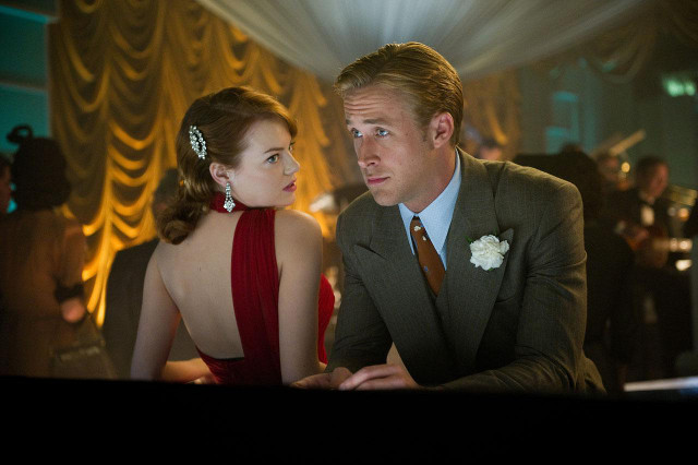 SPARKS FLY. Emma Stone as Grace Faraday and Ryan Gosling as Sgt Jerry Wooters. All movie stills from Warner Bros Pictures