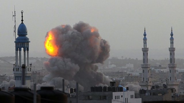 UNDER SIEGE. A fire ball rises as the Israeli air force carries out a raid over Gaza City on November 17, 2012, for the fourth consecutive day. AFP PHOTO/MAJDI FATHI