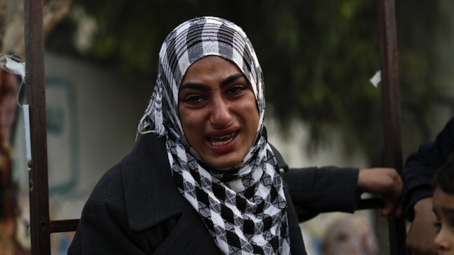 GAZA ATTACKED. A Palestinian woman cries after she evacuated her home to take shelter at a United Nations (UN) school in Gaza City on November 20, 2012. AFP PHOTO/ MOHAMMED ABED