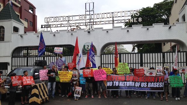 NO TO US BASES: About 60 members of militant groups protest in front of the military headquarters in Camp Aguinaldo. Photo by Carmela Fonbuena/Rappler