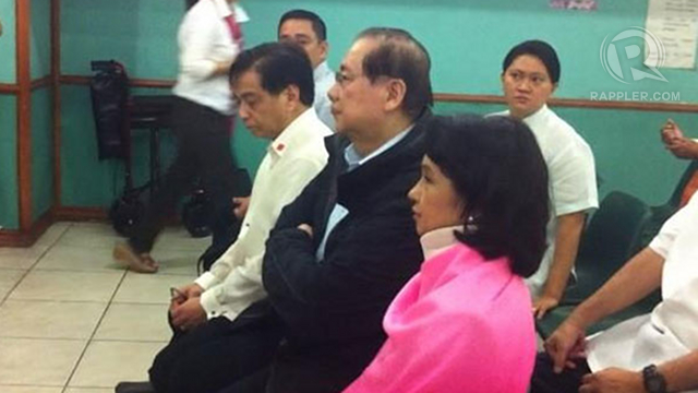 Former president Gloria Arroyo (C) awaits the start of the arraignment of the PCSO plunder case at the Sandiganbayan, October 29, 2012. Photo by Natashya Gutierrez.