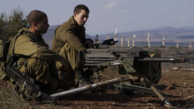 SPILLOVER OF VIOLENCE. Israeli soldiers stands in an abandoned military outpost overlooking the ceasefire line between Israel and Syria on Tal Hazika near Alonei Habshan in the Israeli-occupied Golan Heights on November 15, 2012. AFP PHOTO/STR