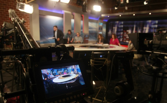 ... . Employees of Greek state broadcaster ERT report live at ERT