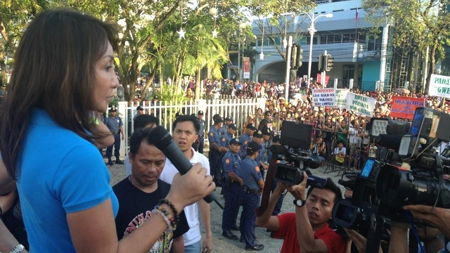 "'WARNING YOU.' Cebu Governor Gwen Garcia warns Cebu's police chief she will hold him responsible should anything happen to her son. The police admit they are tailing her son but denied involvement in the province's running ""political and legal battle."" File photo from Christina Frasco's Twitter account"