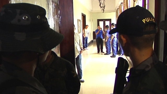 FOLLOWING ORDERS. Policemen padlocked the office upon orders from the Cebu acting governor
