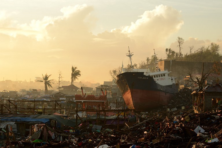 STORM SURGE AFTERMATH. A ship washed ashore by storm surges during the height of Super Typhoon Haiyan (Yolanda) sits atop crushed houses in Tacloban, Leyte in November 25, 2013. AFP/Noel Celis