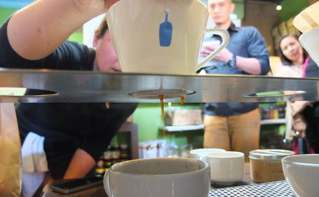 LET IT DRIP. Coffee drips from the ceramic dripper into a mug as demonstrated by Selina. Photo by Pia Ranada