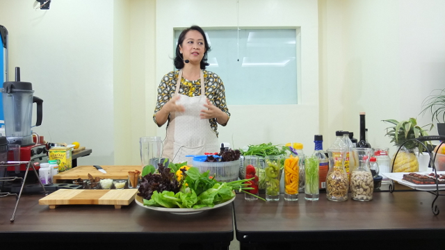 Raw food chef Aileen de Guzman explains the concept of raw foodism to members of the media during the launch of her raw food workshops