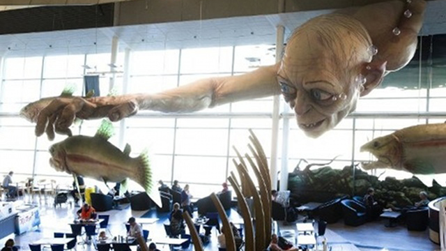 "WELCOME. A giant Gollum creature from the ""Hobbit"" movie catches a fish on the ceiling of Wellington Airport as part of promotions for the upcoming ""The Hobbit"" movie. Photo by AFP"