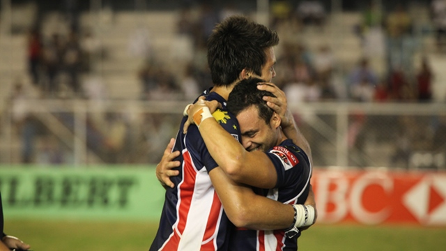 FINALLY. Patrice Olivier and Joe Matthews share a celebratory hug. April 21, 2012. Adrian Portugal.