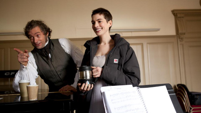 GREAT ACTORS, GOOD HEARTS. Hugh Jackman and Anne Hathaway during the filming of 'Les Miserables.' Photo from the movie's Facebook page