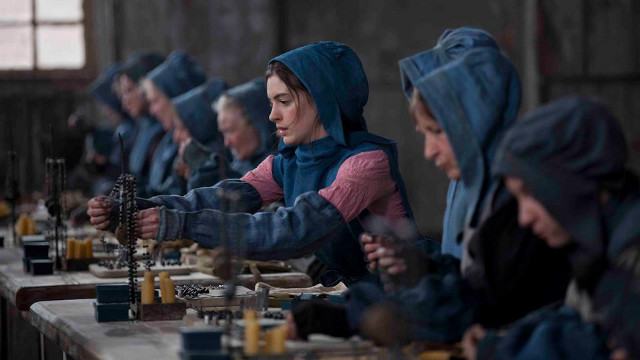 'THIS PAIN LIVES IN THIS WORLD.' Anne Hathaway works like a slave in one of the film's scenes. Photo from the movie's Facebook page