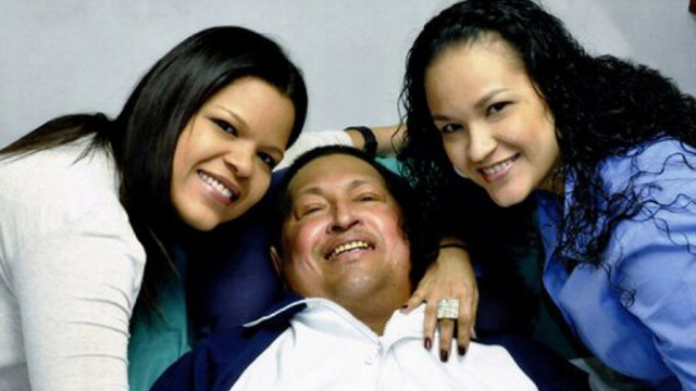 RECOVERING. Venezuela's President Hugo Chavez surrounded by his daughters at a hospital in Havana. Photo from AFP