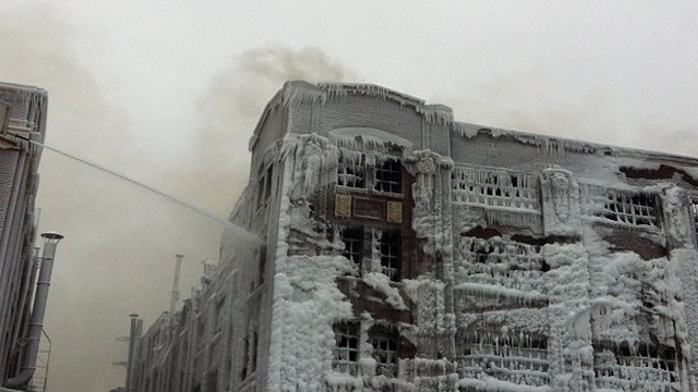ICE WATER. Ice forms as firefighters battle blaze in Chicago. Photo by Ziad Jaber/ NBC News