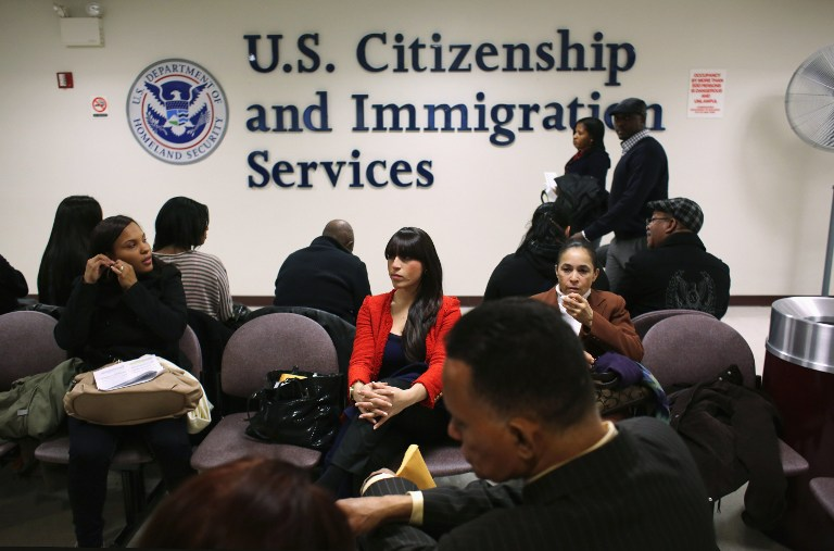 Immigrants wait for their citizenship interviews at the U.S. Citizenship and Immigration Services (USCIS), district office on January 29, 2013 in New York City. John Moore/Getty Images/AFP