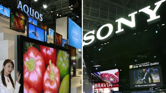 ELECTRONICS GIANTS. This photo shows Sharp's (L) and Sony's large LCD TVs at their booths at a trade show in Chiba. Photo courtesy of AFP