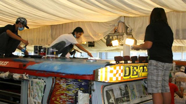 VOLUNTEERS PAINT THEIR FAVORITE Philippine destinations on a lucky jeepney