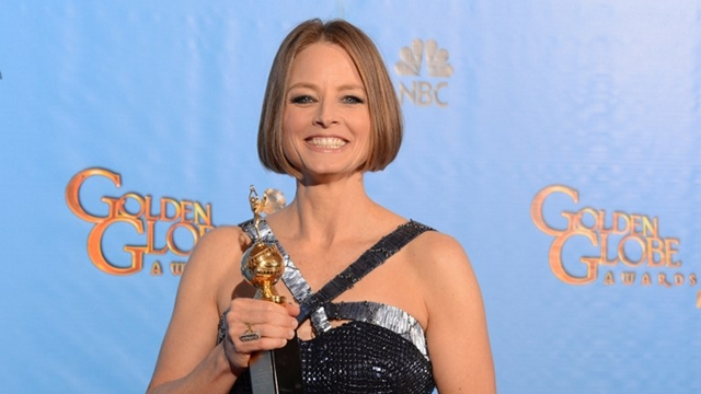 BIG SPEECH. Actress Jodie Foster poses in the press room with her Cecil B. DeMille award after delivering a coming out speech at the Golden Globes awards ceremony in Beverly Hills on January 13, 2013. AFP PHOTO/Robyn BECK