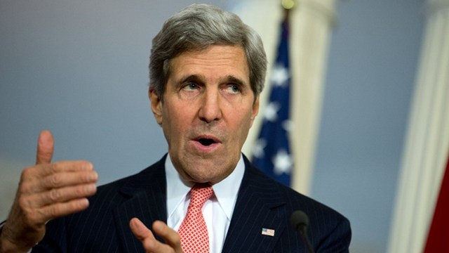 PUSHING THROUGH. US Secretary of State John Kerry arrives in the Philippines on Dec 17. File photo by Nicholas Kamm/AFP