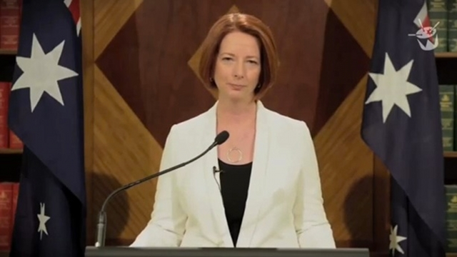 "'WORLD ENDING.' Australian Prime Minister Julia Gillard records a spoof video warning about the end of the world due to ""Korean pop and flesh-eating zombies."" Screenshot from Gillard's video"