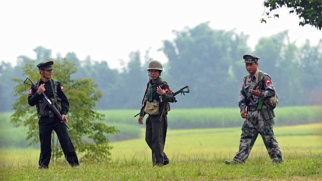ETHNIC CONFLICT. Kachin Independence Army (KIA) soldiers patroling in Loije township near Mai Ja Yang, outside Laiza, a town in Myanmar's northern Kachin state home to the ethnic Kachin rebels' headquarters. AFP PHOTO/ Soe Than WIN