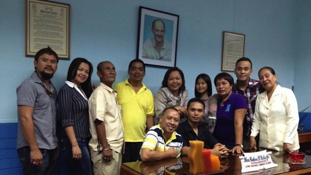 CARETAKER. Akbayan Rep Kaka Bag-ao (standing 5th from left) poses with provincial officials of Dinagat Islands at the office of former Dinagat Rep Ruben Ecleo Jr. Photo from Bag-ao's Twitter account