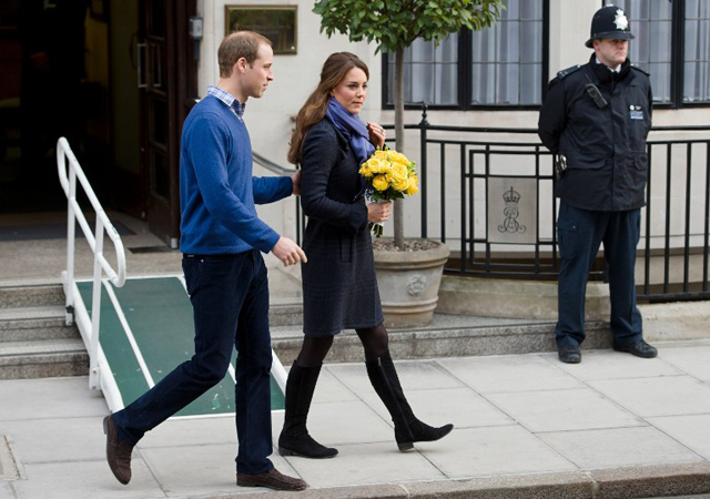 FEELING BETTER. Britain's Prince William, the Duke of Cambridge and his wife Catherine, Duchess of Cambridge, leave the King Edward VII hospital in central London. AFP PHOTO