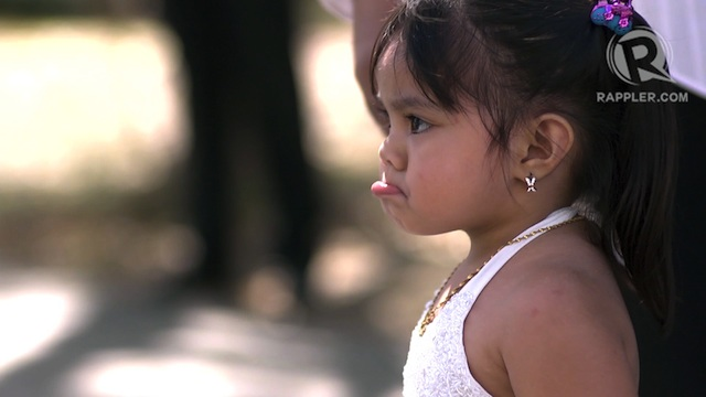 A flower girl waits to walk down the aisle with her parents at the Marikina Hotel. Photo by Patricia Evangelista 14 Feb 2013. 