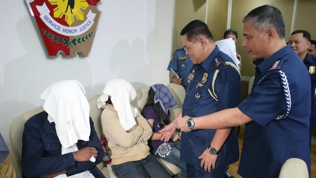 FREED. PNP Director General Alan Purisima greets Indian national Gurtej Singh, wearing a dark blue jacket and a bandage over the missing finger from his right hand. Photo courtesy of PNP