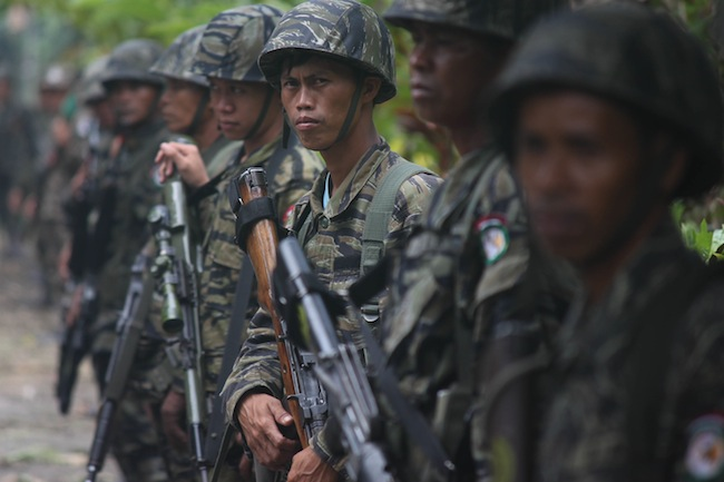 CEASEFIRE. MILF fighters inside Camp Darapanan in Maguindanao. File photo by Karlos Manlupig.
