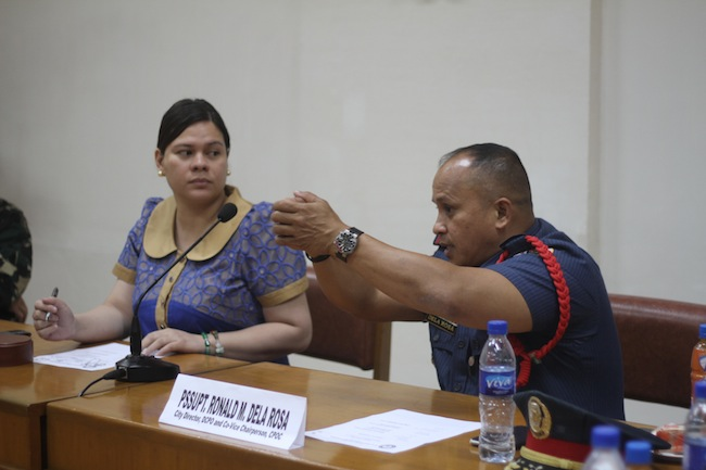 DCPO chief Ronald dela Rosa (right) demonstrates to Mayor Sara Duterte how he attempted to take down Mohd Noor Fikrie Bin Abd Kahar. Photo courtesy of Karlos Manlupig.
