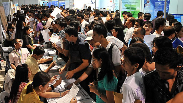 BETTER JOBS. Millions of Filipinos flock to job fairs in the hope of landing quality jobs every year. Photo by AFP.