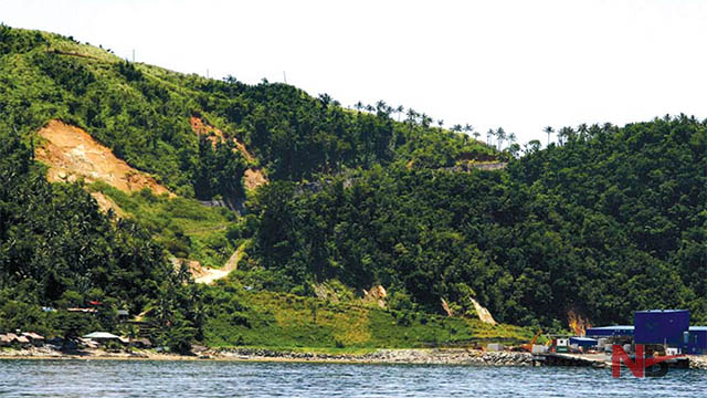 The approach to Rapu-Rapu island reveals natural beauty—from lush, verdant forests to mountainous steep slopes, clear waters, and natural rock formations. Only reddish rocks hint at a possible danger that lurks in the island: red iron sulfate precipitate. File Photo