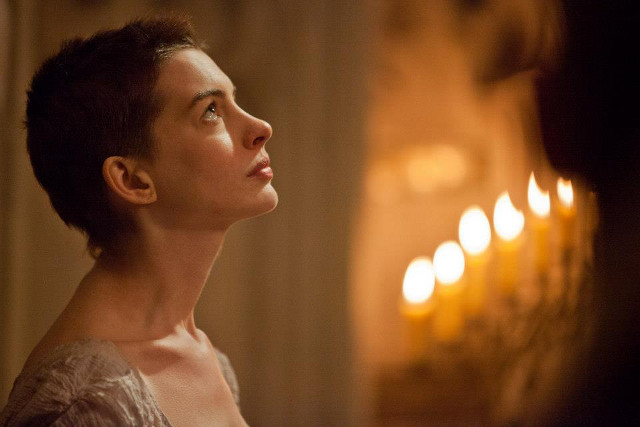 THE WORLD WEEPS AT HER STORY. Anne Hathaway's Fantine. Photos from the 'Les Misérables' Facebook page