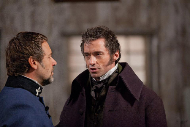 Hugh Jackman's Jean Valjean (right) as Monsieur Madeleine
