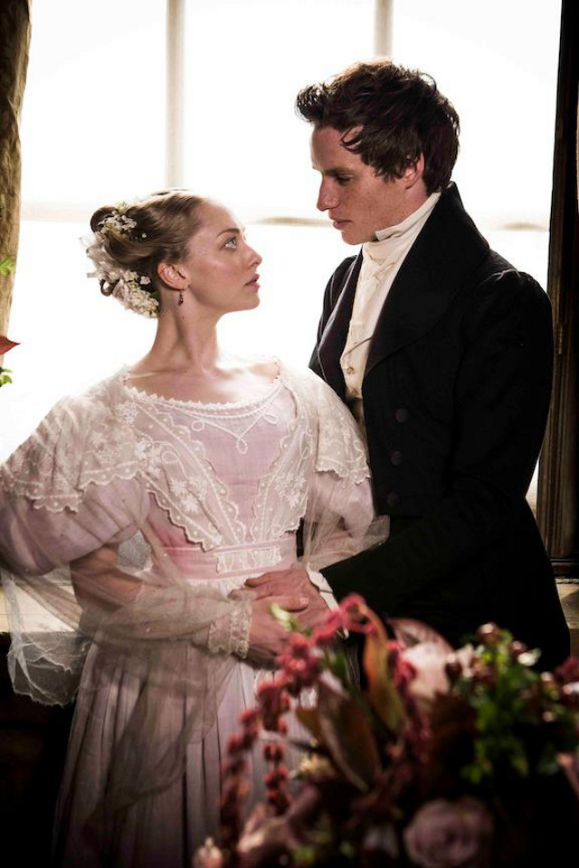 Amanda Seyfried as Cosette (left) and Eddie Redmayne as Marius Pontmercy (right)
