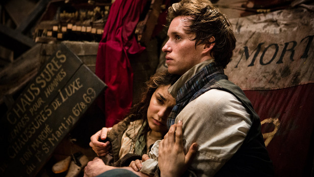 CAN THEY STILL BE FRIENDS? Samantha Barks and Eddie Redmayne as lovelorn youth. All photos by Universal Pictures