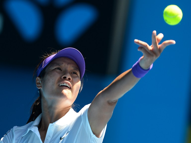 China's Li Na serves against Russia's Maria Sharapova during their women's singles semi-final match on day 11 of the Australian Open tennis tournament in Melbourne on January 24, 2013. AFP PHOTO / WILLIAM WEST 
