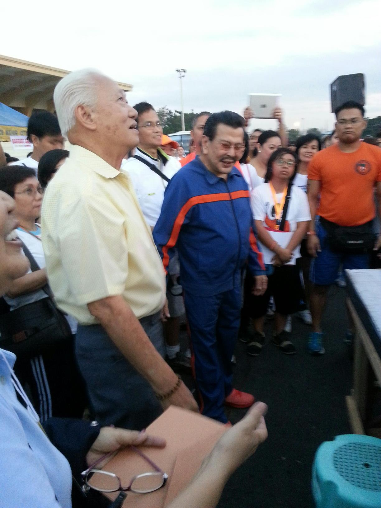 Manila mayoral bets Alfredo Lim (L) and Joseph Estrada (R) share a light moment during a fun run organized by the La Consolacion College in Manila, January 20, 2013. Photo courtesy of the Alfredo Lim campaign.