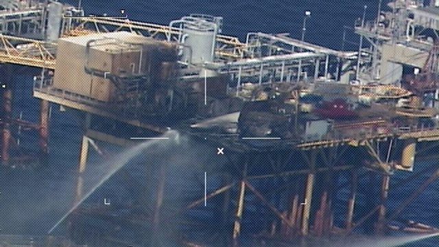 DEADLY BLAST. Commercial vessels spray water to extinguish a platform fire on board the West Delta 32 oil rig in the Gulf of Mexico off Grand Isle, Louisiana on November 16, 2012. AFP PHOTO / HNADOUT / US COAST GUARD