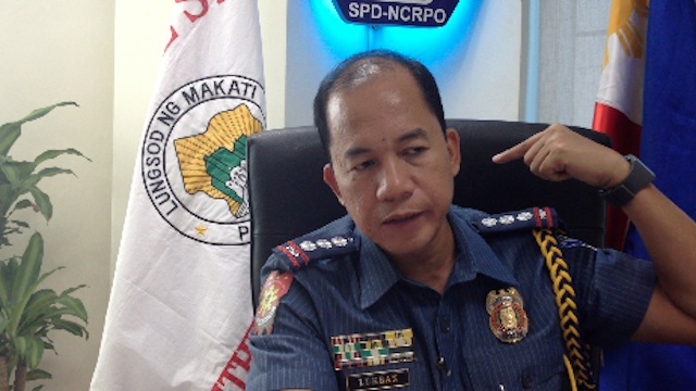 FATAL WOUND. Makati police chief Senior Supt. Manuel Lukban points to the exact spot where the victim received the fatal stab to his neck. Screenshot from video by Carlos Santamaria