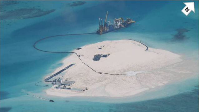 'MORATORIUM' SOUGHT. The Philippines wants a moratorium on activities that raise tensions in the South China Sea. This image dated Feb 25, 2014 shows China's reclamation activities in the disputed waters. Photo courtesy of DFA