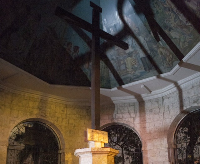 CHRIST'S CROSS. The Magellan's cross is littered with candles left by devotees after performing a prayer dance. Photo by Jon Cabiles